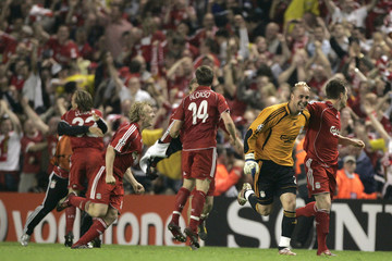 Liverpool's players celebrate after scoring the winning penalty against Chelsea during their Champions League semi-final, second leg soccer match in Liverpool