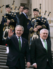 U.S. President George W. Bush and Ireland's Prime Minister Bertie Ahern walk down the steps of Capitol Hill in Washington