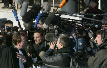 LAWYER RIVIERE ANSWERS REPORTERS QUESTIONS AT THE ARLON COURTHOUSE.