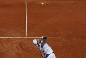 Germany's Kiefer serves the ball to Argentina's Acasuso during their first round match at the Swiss Open ATP tennis tournament in Gstaad