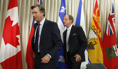 Manitoba Premier Doer and Saskatchewan Premier Wall leave a news conference after a Council of the Federation meeting in Montreal