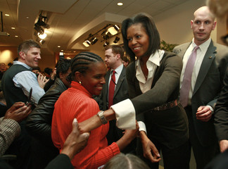 U.S. First Lady Michelle Obama greets employees during her visit to the Department of Education in Washington