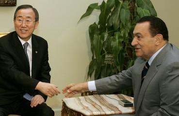 U.N. Secretary-General Ban Ki-moon shakes a hand with Egyptian President Hosni Mubarak in Cairo