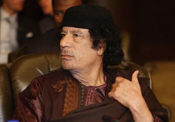 Libyan leader Muammar Gaddafi attends the opening of the two-day Arab Summit in Damascus