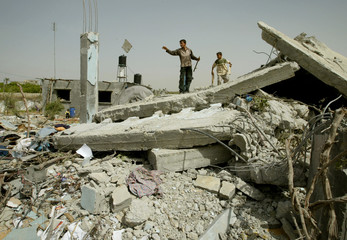 PALESTINIANS INSPECT DEBRIS OF THEIR FAMILY HOUSE AFTER IT WASDEMOLISHED BY ISRAELI BULLDOZERS AT ...