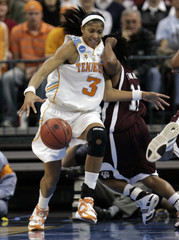 Tennessee guard Parker collides with Texas A&M guard Franklin in NCAA women's regional final basketball game in Oklahoma City