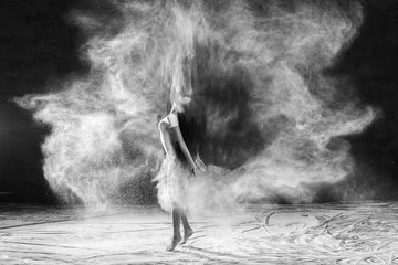 Black and white portrait of young dancer with white flour flipping from her hair