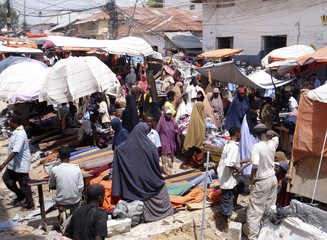 People conduct their business activities at the Bakara open-air market in Mogadishu