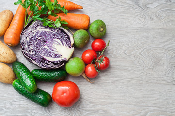 A set of fresh vegetables on a wooden table. The concept of a healthy diet.