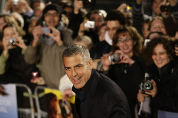 """U.S. actor Clooney poses for photographers as he arrives for the gala screening of the film """"The men who stare at goats"""" in Leicester Square in London"""