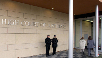 SCOTTISH POLICEMEN GUARD LOCKERBIE COURTHOUSE AT SOESTERBERG.