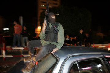 A Palestinian Hamas militant attends a Hamas rally in Gaza