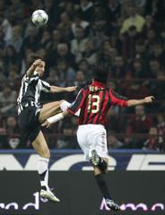 AC Milan's Nesta challenges Juventus' Ibrahimovic during Italian Serie A soccer match in Milan