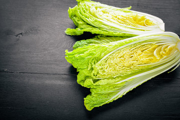 fresh chinese cabbage on wooden table. Top view.