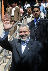 Palestinian PM Haniyeh waves after news conference in Gaza