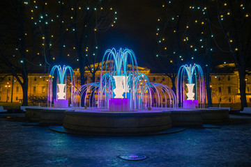 Lighted fountain near the Winter Palace