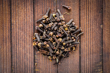 allspice. On Wooden background. Top view.