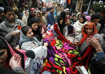 Women buy wool scarves ahead of Eid al-Adha festival in Srinagar