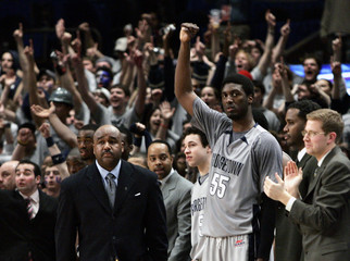 Georgetown University Hoyas head coach Thompson III walks the sideline as Hibbert celebrates in the second half of their NCAA basketball game against the University of Pittsburgh Panthers in New York