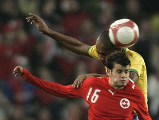 Switzerlands Barnetta challenges Brazil's Maicon during their international friendly soccer match in Basel