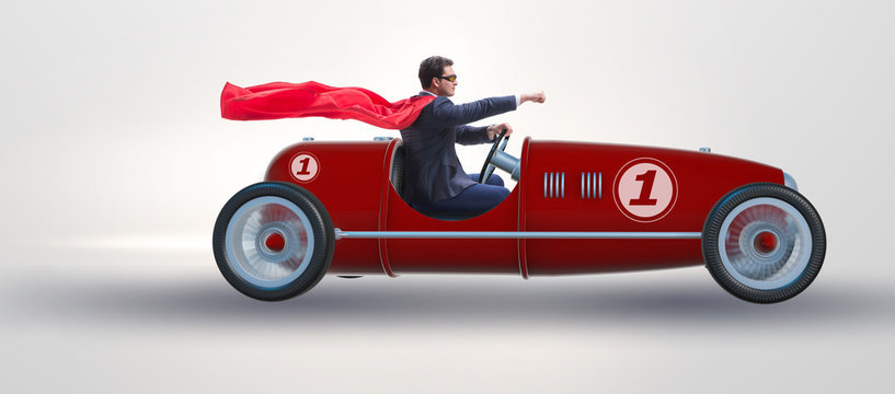 Superhero businessman driving vintage roadster