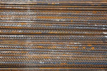 Thick rusty rebar-rods, metallic texture pattern.