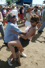 Dancers move to Zydeco music during New Orleans Jazz Fest.