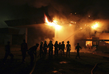 Firefighters battle a blaze at the domestic departure terminal at Medan's Polonia airport