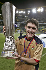 CSKA Moscow player Zhirkov holds the trophy after his team won 3-1 against Sporting during the ...