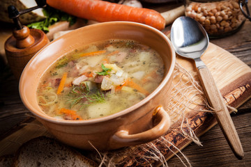 Pea soup with vegetables and bacon.
