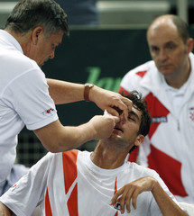 Cilic of Croatia receives treatment during his tennis match against Capdeville of Chile in first round World Group Davis Cup in Porec