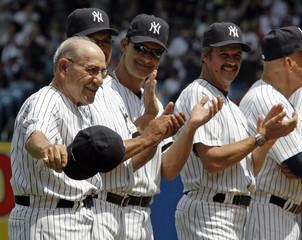 Yogi Berra  tips his cap at Old Timers Day before Los Angeles Angels of Anaheim play New York Yankees in New York