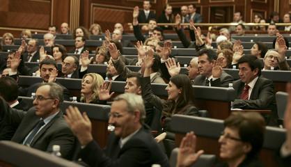 Kosovo deputies vote during a session of the Kosovo parliament in Pristina