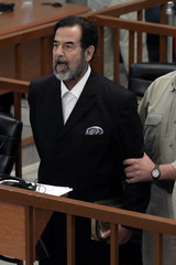 Former Iraqi president Saddam Hussein yells in court as he receives verdict during trial in Baghdad