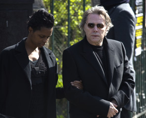 French singer Yves Simon leaves after funeral services for late French singer Alain Bashung at the Saint-Germain-des-Pres church in Paris