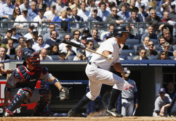 Yankees' Damon hits a single in the first inning of action against the Indians during the first regular season MLB baseball game played at the new Yankee Stadium in New York