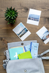 journey planning with tourist outfit on wooden table background top view