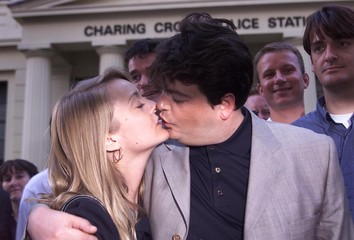 DAVID SHAYLER KISSES HIS GIRLFRIEND UPON LEAVING POLICE STATION.