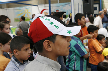 Iraqi refugees wait to register at the U.N. Higher Commissioner for Refugees (UNHCR) office in Douma