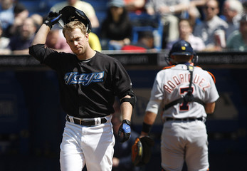 Blue Jays Hill reacts to striking out in front of Tigers catcher Rodriguez  in Toronto