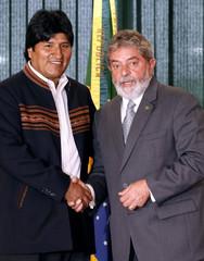 Brazil's President Lula da Silva and his Bolivian counterpart Morales shake hands before their meeting at Planalto Palace in Brasilia
