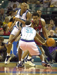 HORNETS ROBINSON KNOCKS BALL LOOSE FROM PISTONS VAUGHT.