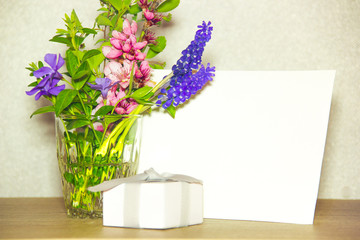 Blank card, present and flowers