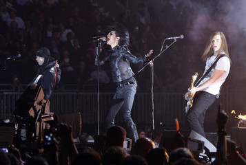 Members of German rock band Tokio Hotel perform during the MTV Europe Awards ceremony in Berlin