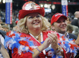 Ohio alternate delegate Eshelman applauds during third session of 2008 Republican National Convention in St. Paul
