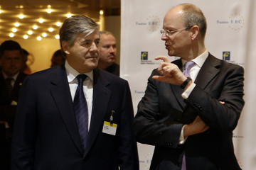 Ackermann CEO of Deutsche Bank, chats with Blessing, CEO of Commerzbank during the European Banking Congress in Frankfurt
