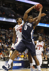 Villanova's Pena pulls down a rebound in front of Clemson's Hammonds during their first round NCAA men's basketball tournament game in Tampa