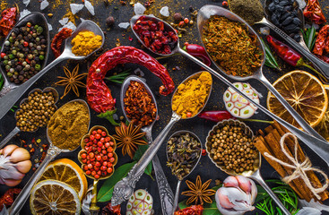 Zelfklevend Fotobehang Kruiden Spices and herbs in metal bowls. Food and cuisine ingredients. Colorful natural additives.