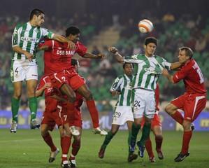 Real Betis' Luis Eduardo Schimidt jumps for the ball next to AZ Alkmaar's Van Galen during their UEFA Cup soccer match in Seville