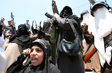 Armed Palestinian women protest against Israeli attacks in Gaza Strip and Lebanon